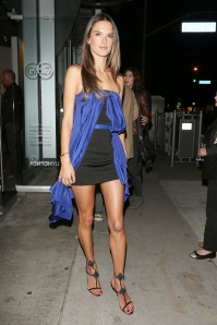 Alessandra Ambrosio, wearing a short black and blue dress, attends an art event at the Guy Hepner Gallery in Los Angeles