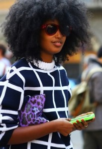 MILAN-FASHION-WEEK-STREET-STYLE-SS-2013-SPRING-SUMMER-2013-GRAPHIC-PRINT-SWEATER-CHECKERED-LINE-SWEATERPURPLE-LEOPARD-CLUTCH-NEON-IPHONE-CASE-BIG-HAIR-GOLD-RING-OVERSIZED-RED-SUNGLASSES-VIA-VOGUE.jpg