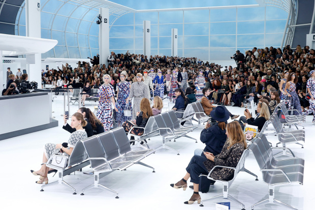 "PARIS, FRANCE - OCTOBER 06:  Illustration view of Models in the ""Chanel Airport"" during the Chanel show as part of the Paris Fashion Week Womenswear Spring/Summer 2016 on October 6, 2015 in Paris, France.  (Photo by Rindoff/Le Segretain/Getty Images)"